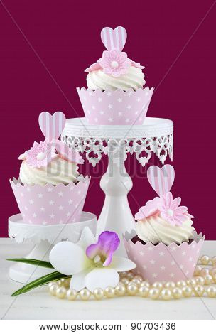 Wedding Concept Cupcakes On Marsala Background.