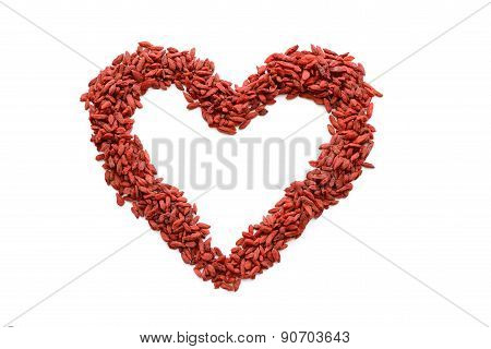 Red heart figure made from many dried Goji berries. Heart sign