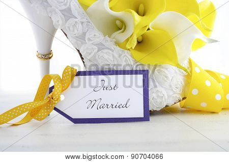 Wedding Ring On Beautiful White Stiletto Shoe Heel.