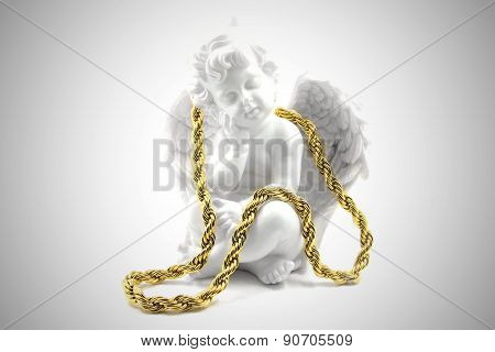 Gold necklace with an angel