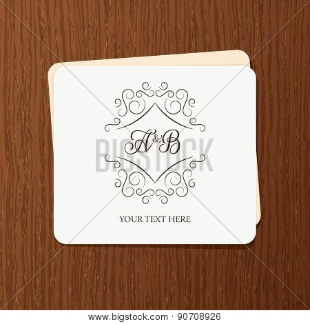Vintage frame for weddings, invitations, greeting cards, menus, business identity. Elegant vector calligraphic card design on wood texture background.