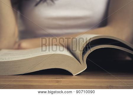 Open Book On Wooden Table Closeup