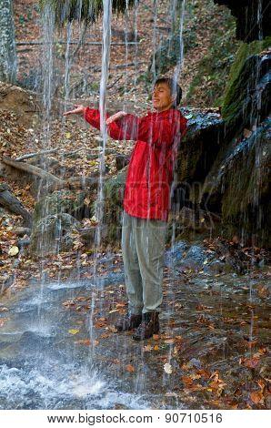 Tourist Under The Waterfall