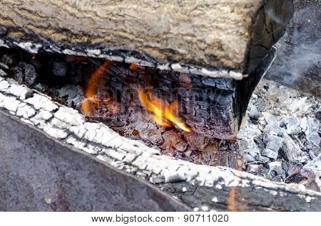 Burning Flame The Coals In The Grill