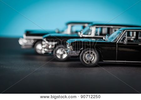 Vintage Toy Cars Standing Sideways