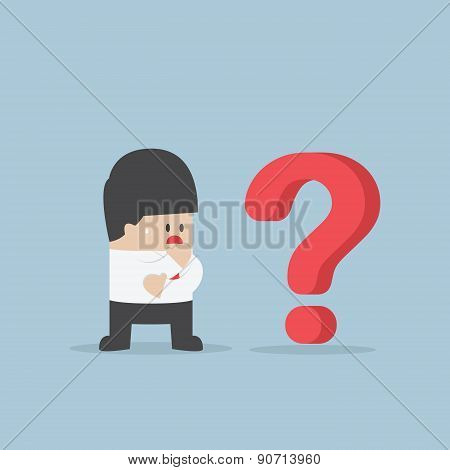 Businessman Thinking While Looking At Question Mark