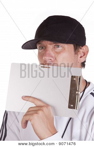Coach Behind Clipboard