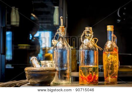 Bottles Of Stagnant Oil On Pepper