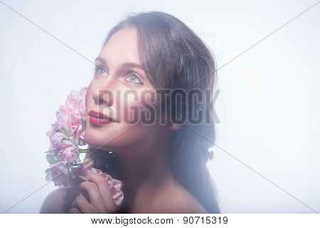 Girl in a wreath of beautiful flowers