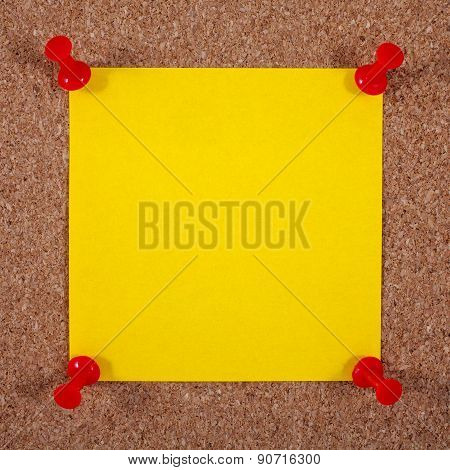 Blank Yellow Note Page Pinned To A Noticeboard