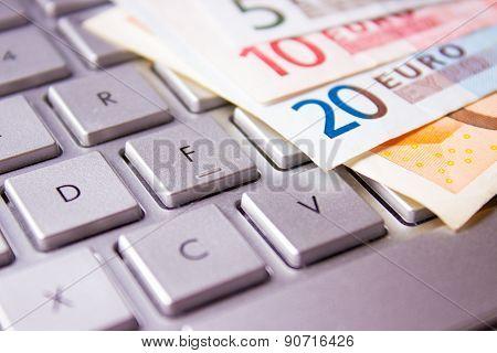 Euro Banknotes On A Computer Keyboard