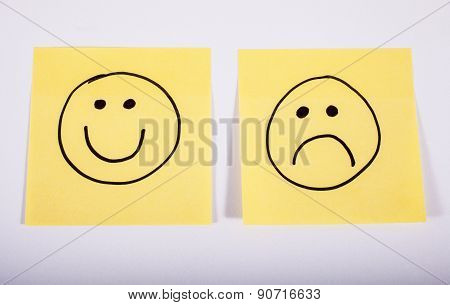 Happy And Sad Faces On Memo Paper