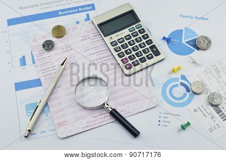 Magnifying Glass, Pen And Coin On Graph Paper, Saving Concept