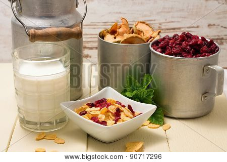 Portion Of Cornflakes And Two Aluminum Cups With Dried Fruit