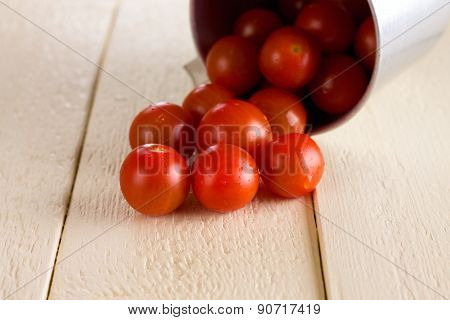 Red Cherry Tomatoes Spilled On White Wooden Board