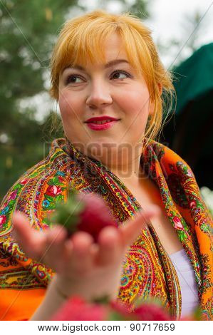 Portrait Of A Young Woman With Strawberries. She Laughs, Smiles, Flirts
