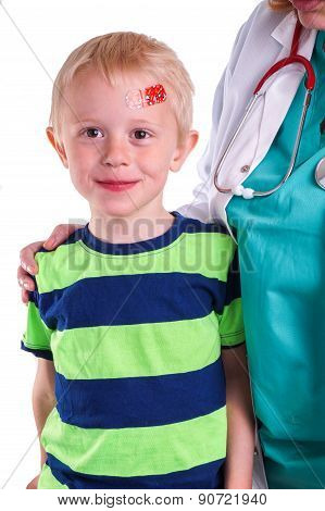 Boy Has Injury On Forehead And Gets Help By The Doctor