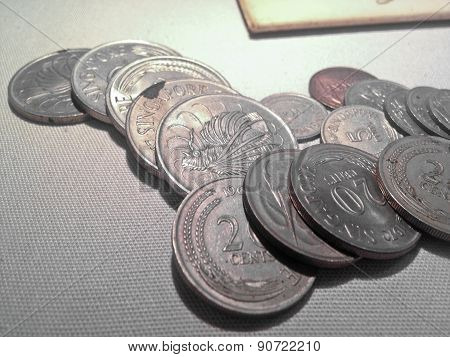 Singaporean Silver Coins Laying Together