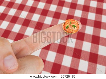 Dish With Pizza Margherita In Miniature On The Finger