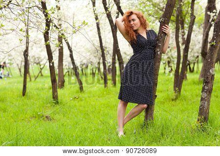 Woman Near A Tree