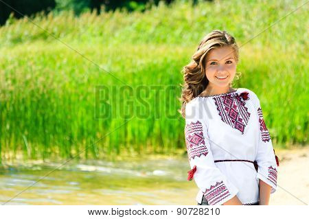 Happy Girl In The Ukrainian National Clothes Embroidery On The Riverside