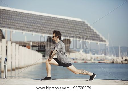 Athletic Man Warming Up Before H?? Workout In The Urban City. Runner Training Outdoors, Healthy Life