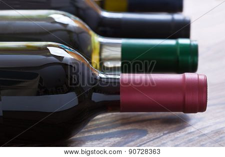 Wine bottles on wooden background