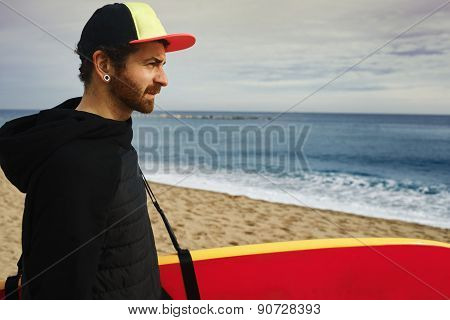 Man With Stand Up Paddle Board Or Sup On The Beach.