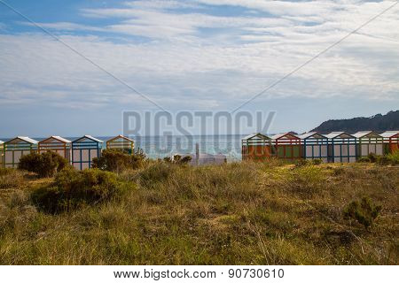 Colorful Beach Huts In Good Weather.