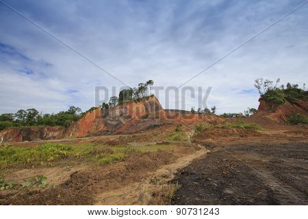 KUCHING, MALAYSIA - MAY 16 2014: Deforestation. Photo of tropical rainforest in Borneo being destroyed to make way for oil palm plantation.