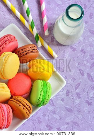 french colorful macarons and milk
