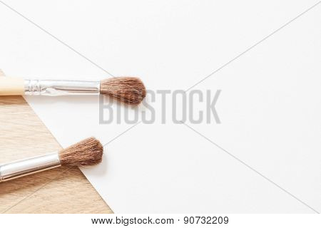 two wooden brush on a white blank sheet of paper. background