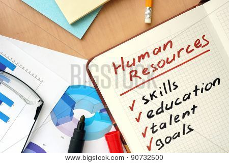 Notepad with words human resources concept.