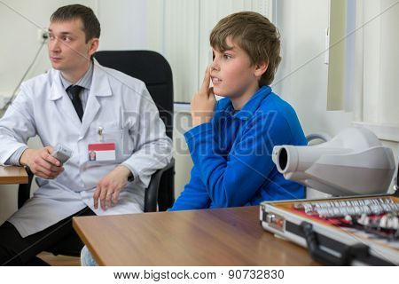 teenager checks sight at the reception of an ophthalmologist
