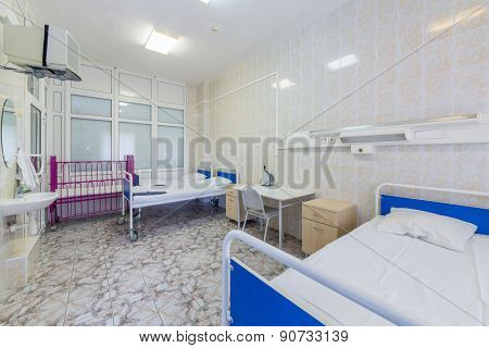 hospital ward with beds and tables