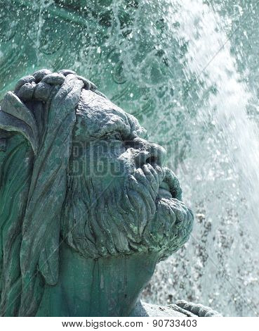 Face Of Sculpture In Water Fountain