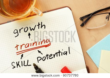 Notepad with word growth, training, skill and potential concept.