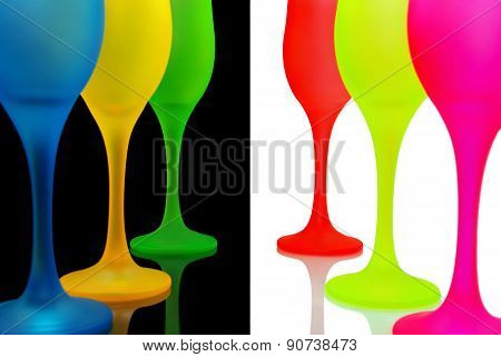 Multi-colored wine glasses isolated on white and black background