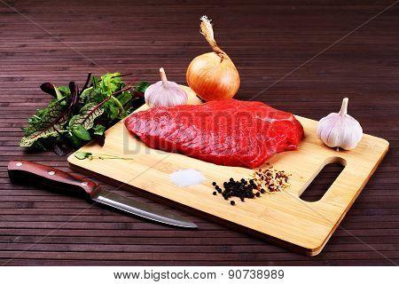 Raw Beef Roast With Fresh Herbs - Stock Image