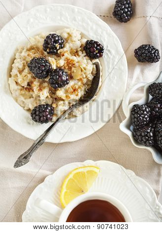 Homemade Oatmeal With Blackberries, Granola And Honey For Breakfast.