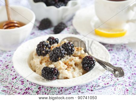 Homemade Oatmeal With Blackberries, Granola And Honey For Breakfast