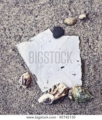 Beach background with copyspace, beach sand summer theme, sea shels, stones over sand texture and wh