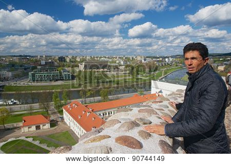 Tourist enjoys the view to the city from Gediminas hill in Vilnius, Lithuania.