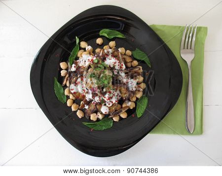 Salad With Aubergines, Dates And Chick Peas.