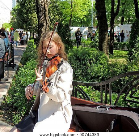 The Girl Playing The Violin For Free In The City Square