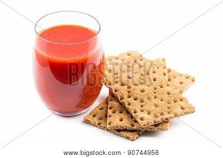 Wheat Crisp Bread And Tomato Juice In Glass