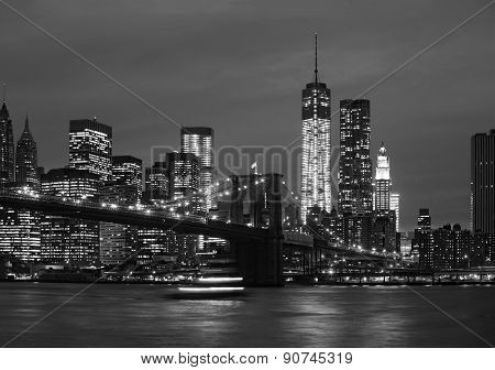 Manhattan At Night With Lights And Reflections
