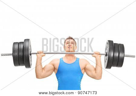 Close-up on a male weightlifting athlete lifting a heavy weight isolated on white background