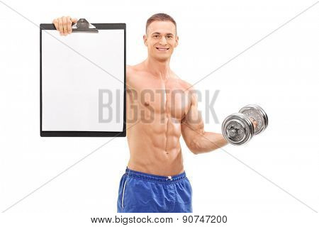 Young handsome athlete posing shirtless and holding a barbell and a clipboard with a blank paper on it isolated on white background