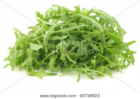 fresh rucola leaves (Eruca sativa)  on a white background